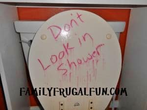 Funny, scary and easy bloody Toilet Halloween Party Decorations for the bathroom. Use dollar store red lipstick or dry erase marker. #Halloween #HalloweenDecorations #HalloweenParty #HalloweenDIY