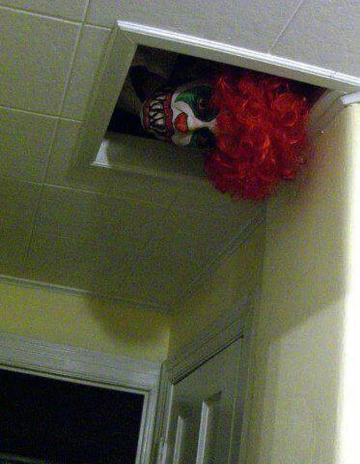 Easily place a clown mask and wig to peek out of the air vent for Halloween bathroom decorations that will scare the crap out of them.