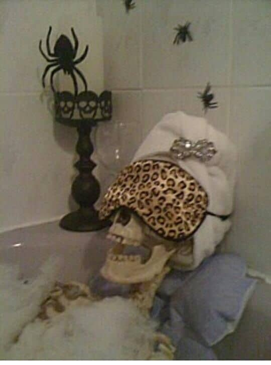 A dollar store skeleton and some of your glamour bath products can create the best Halloween bathroom Decoration