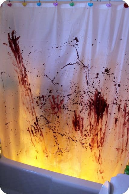 Easy DIY Bloody Halloween Bathroom Decorations- Shower curtain idea