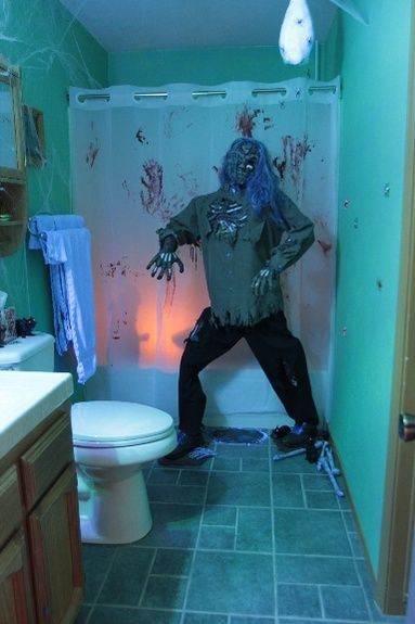 So men can feel someone looking over their shoulder when they're doing their business. Easy DIY Halloween Bathroom decorations that will scare the crap out of them