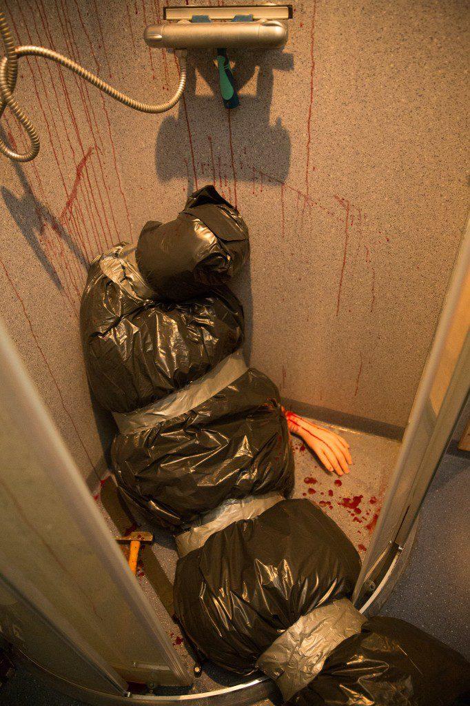 Easy DIY bloody body bag Halloween bathroom decor idea for a small shower
