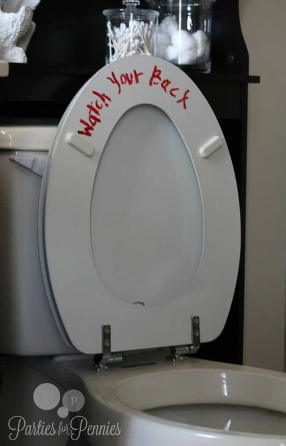 Funny, scary and easy bloody Toilet Halloween Party Decorations for the bathroom. Use dollar store red lipstick or dry erase marker.