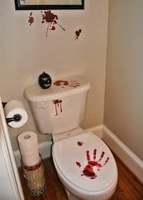 Make them pee a little faster with these easy Bloody Toilet hand prints and Halloween Bathroom Decor