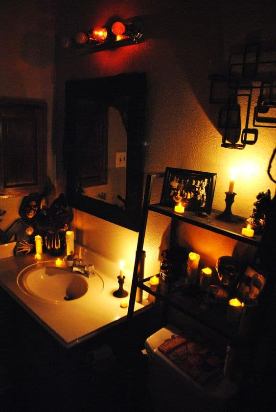 Candles, and flameless candles easily create a spooky ambiance for Halloween Bathroom decorations be sure to remove your light bulbs