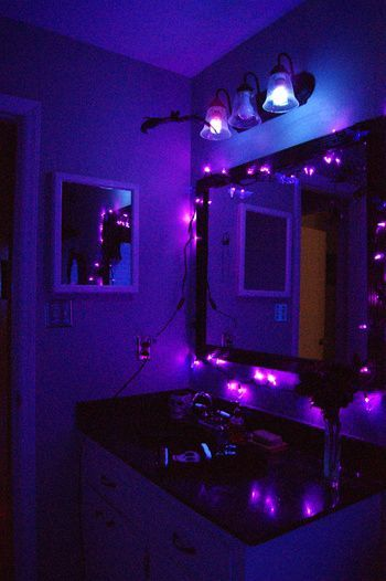 Black lights and string lights combined for Halloween Bathroom Decorations that will scare the shit out of them
