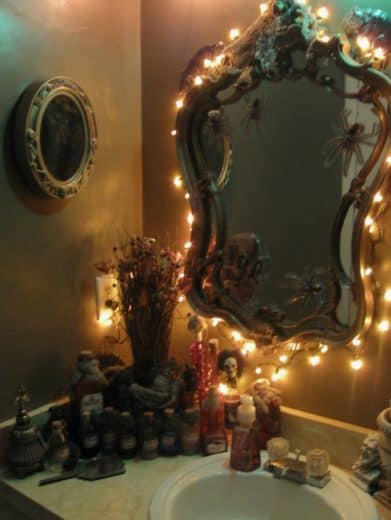 String lights create a spooky ambiance for Halloween Bathroom Decorations just be sure to take out your light bulbs