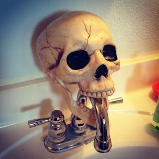 Easy diy Halloween Bathroom decorations for the faucet using a dollar store skull