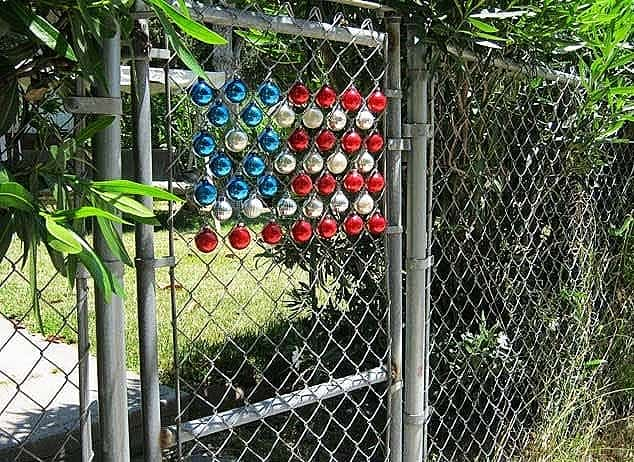 Easy DIY 4th of July gate Decoration idea for your gate using Christmas Ornaments. Easy 4th of July party ideas.