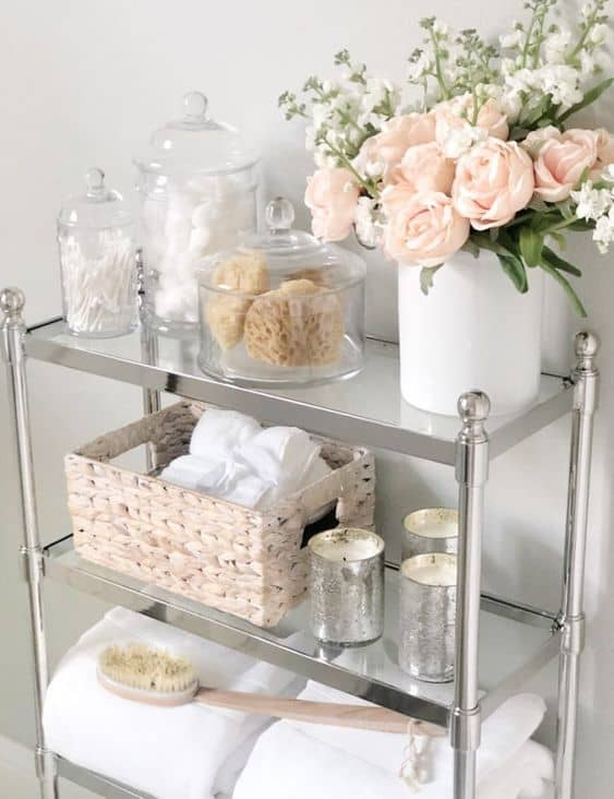 Bathroom shelves control clutter and provide extra storage in a small bathroom