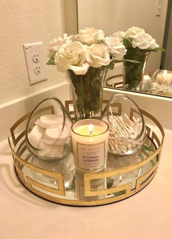 The best easy DIY small Bathroom decor ideas on a budget for apartments using a tray and canisters for storage and organization