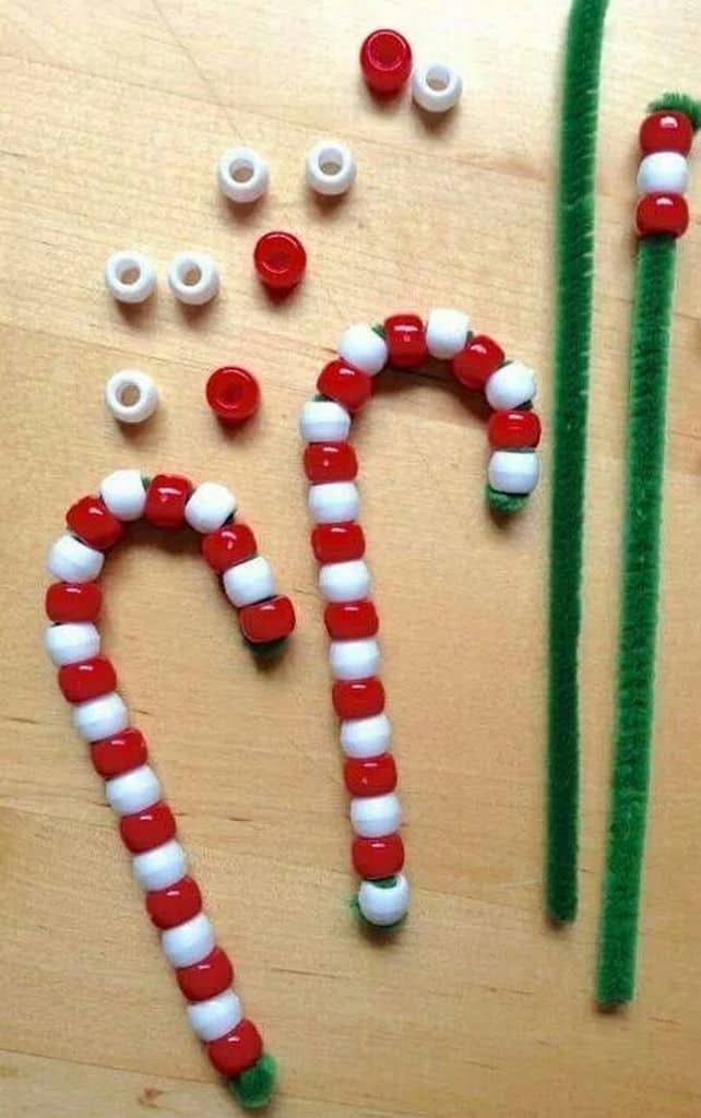 Easy DIY Christmas Ornament Craft kids can make. Cute beaded candy cane for the Christmas tree.