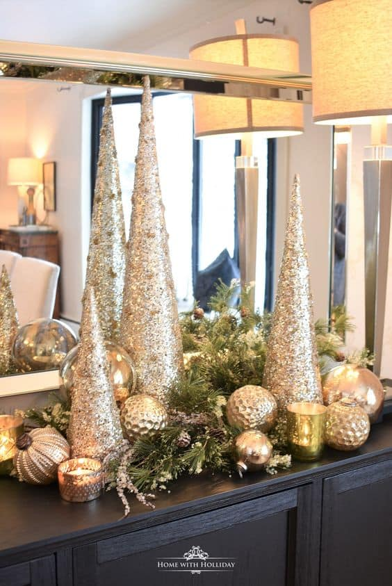 Easy DIY Elegant Silver and Gold Metallic Christmas Cone Decoration Ideas. Perfect for the mantle, the table, or as a tree alternative. Budget friendly decorating for the home, a party or winter wedding.