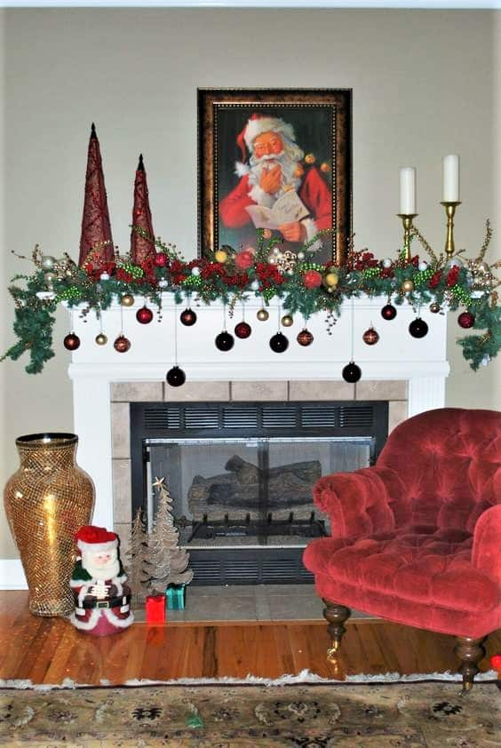 Easy DIY hanging mantel ornaments using ribbon and garland. Elegant Christmas decoration idea for mantle, window, ceiling, or wall. Great budget decor idea for the home, winter wedding, or Christmas party. Dollar store.