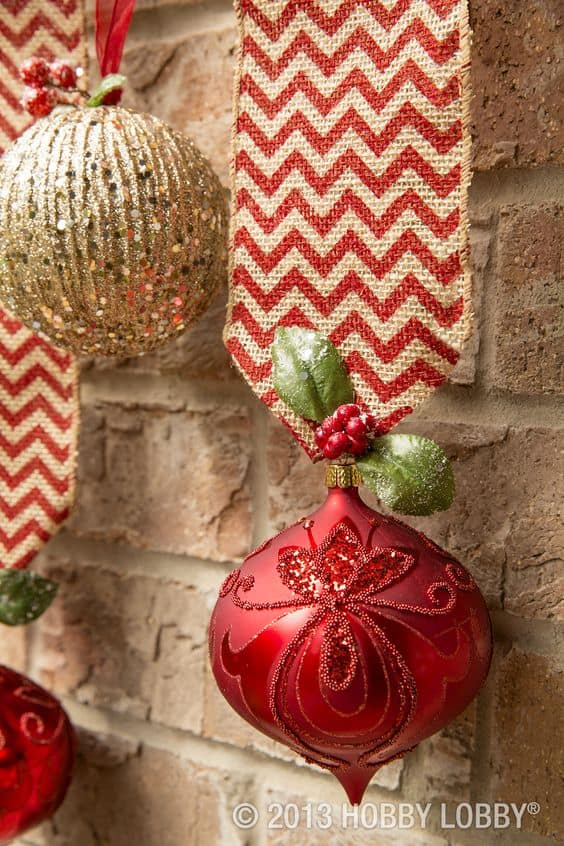 Easy DIY hanging mantel ornaments using burlap. Elegant Christmas decoration idea for mantle, window, ceiling, or wall. Great budget decor idea for the home, winter wedding, or Christmas party. Dollar store.
