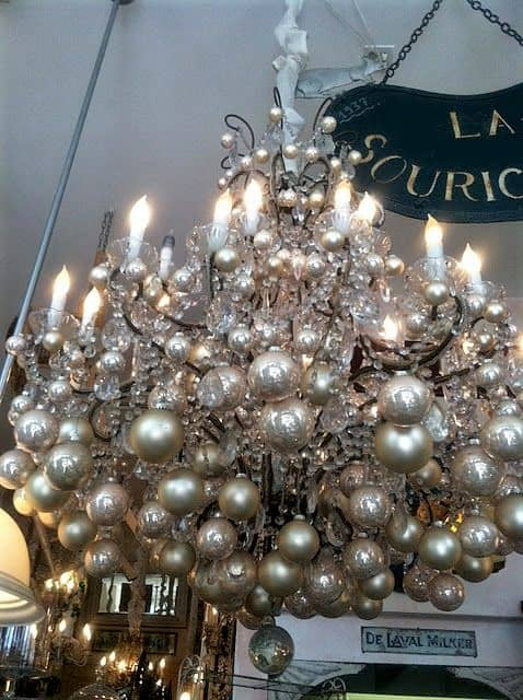 Easy DIY chandelier Christmas decor idea using dollar store ornaments. Elegant Christmas decoration idea for mantle, window, ceiling, or wall. Great budget decor idea for the home, winter wedding, centerpiece, or Christmas party.