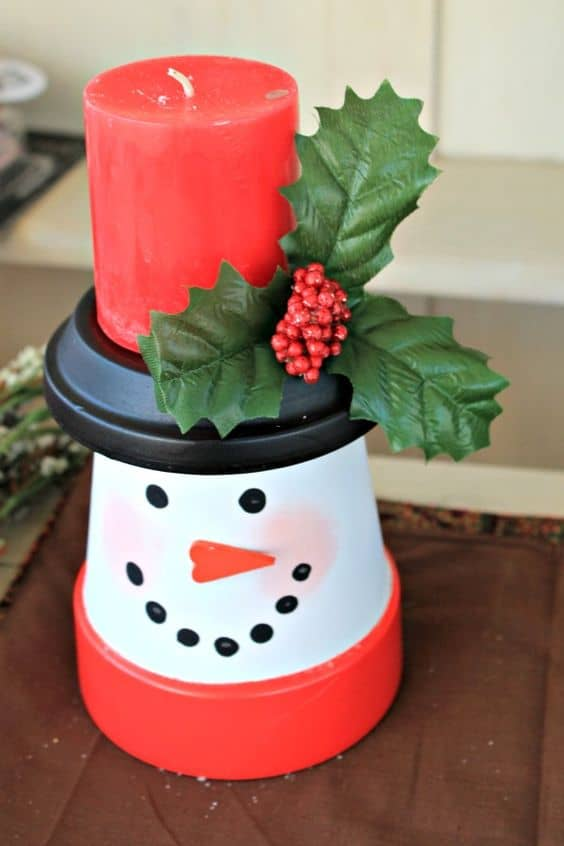 How to make: Easy DIY Candle holder Christmas Decorations using Claypots. Perfect Christmas or winter decoration, DIY gift, craft, or wedding centerpiece. Great Budget decor ideas for the home. #Christmas #ChristmasCrafts #DIYGifts #Kids