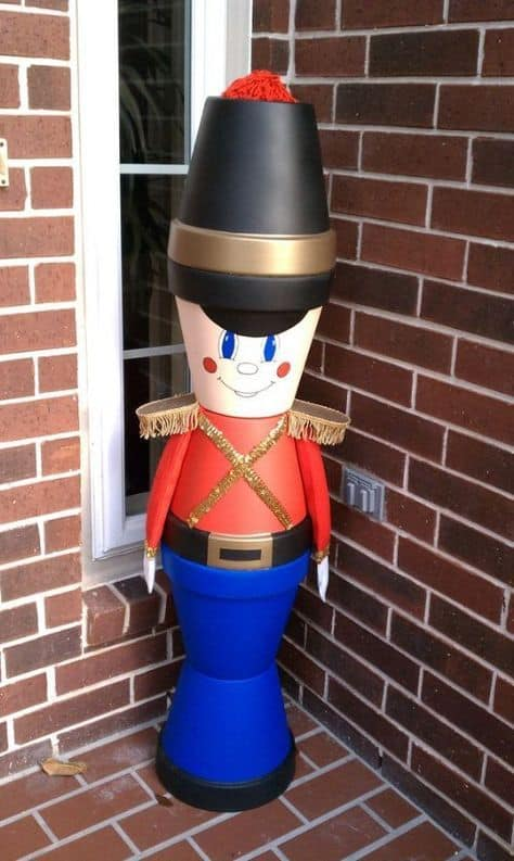 How to make: Easy DIY Clay Pot NutCracker Christmas Decorations using claypots. Perfect Christmas or winter decoration for indoors or out doors. Great Budget decor ideas for the home. #Christmas #Craft