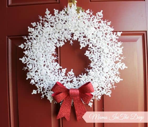 Easy DIY Snowflake wreath. Simple yet beautiful dollar store Christmas craft idea anyone can make, even kids for a party, wedding, or gift.