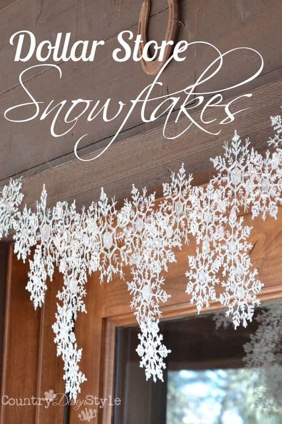 Easy DIY Dollar Store Snowflake garland. Simple yet beautiful dollar store craft idea anyone can make, even kids.