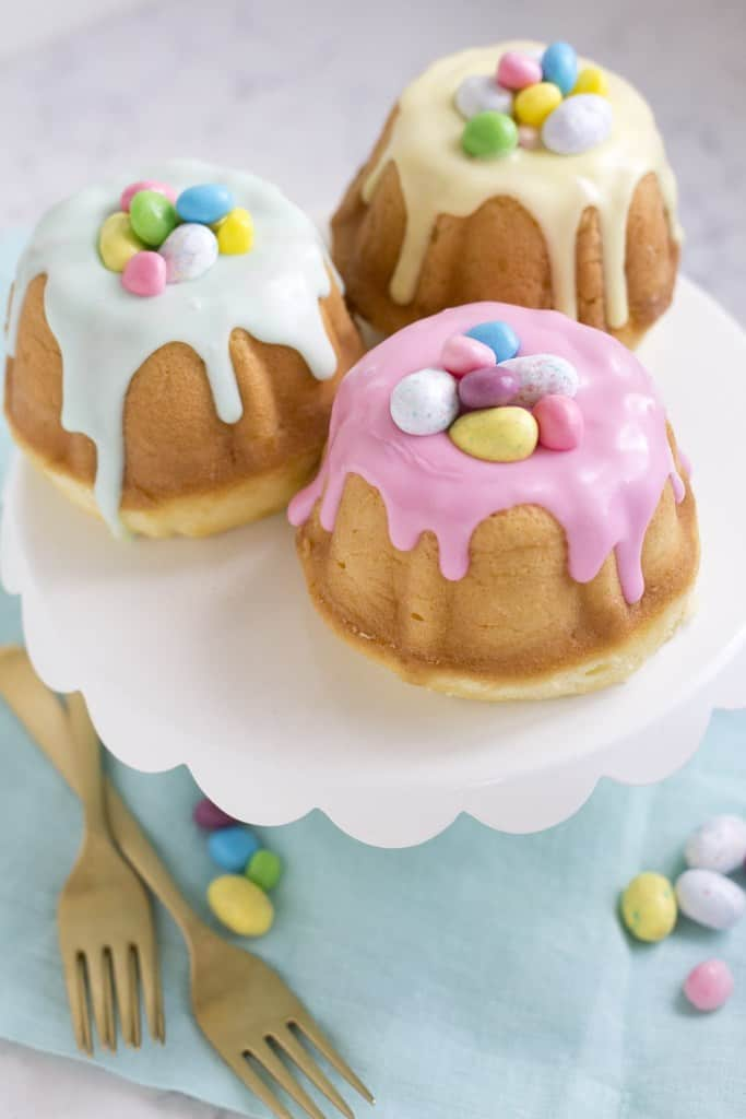 Easy and Elegant Mini Easter Bundt Cakes for kids using candy eggs. Simple Easter cake decorating ideas and dessert recipes.