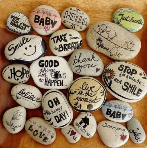 Inspirational words written on rocks with Sharpies. Easy DIY craft gift idea kids can make for Fathers Day
