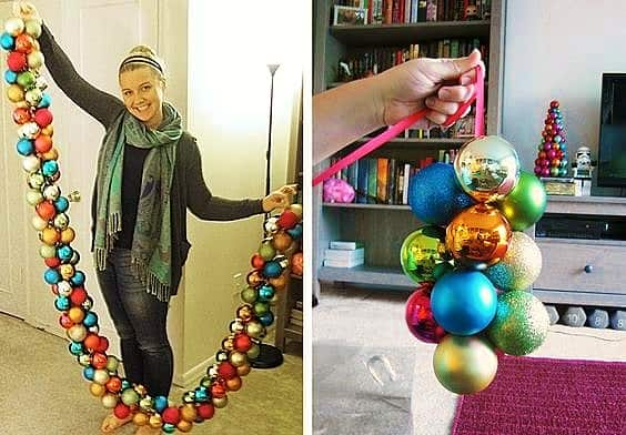 Easy DIY Christmas Garland made of ball ornaments and ribbon. Great to use garland on mantle, on staircase, and doorways. Great holiday decor idea.