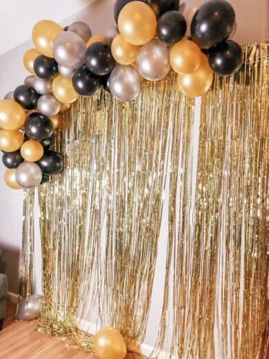 Easy DIY Black and Gold Graduation party photo backdrop booth