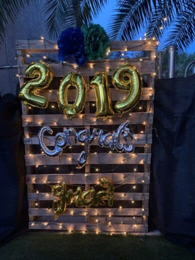 Grad Party Pallet Wood Photobooth with balloons and lights