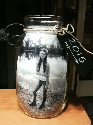 Easy Graduation party picture centerpiece rustic display idea using glass jar for high school and college, boys and girls. Tips and DIY for decorations, pictures, on a budget. #Graduation #GraduationParty #GradParty
