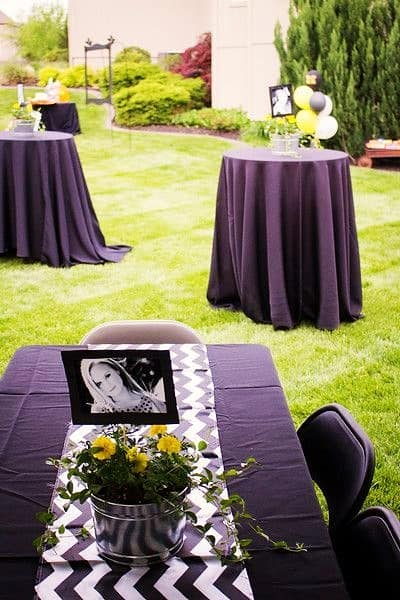 Glue photos to stock paper and sticks and insert into a Black and Gold Graduation Party centerpiece. Easy DIY Graduation Party Decoration Ideas using Pictures.