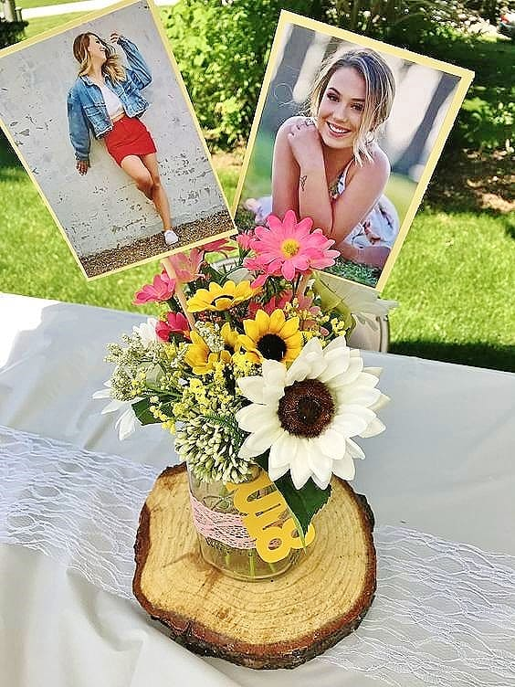 Glue photos to stock paper and sticks and insert into a Rustic Graduation Party centerpiece. Easy DIY Graduation Party Decoration Ideas using Pictures.