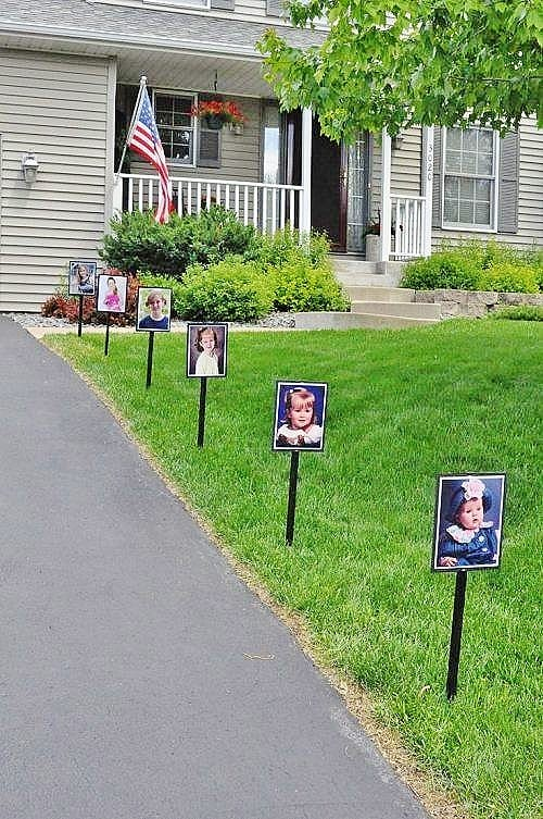 School pictures on stakes lining the driveway.. Easy DIY Graduation Party Decoration Ideas using Pictures.