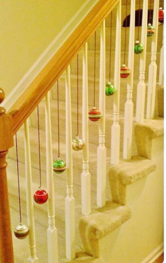 Easy DIY Hanging Ornament Decorations using ribbon. Perfect Christmas decorating idea for the bannister, ceiling, mantle, and wall. Elegant home decor, party decor or winter wedding idea on a budget.
