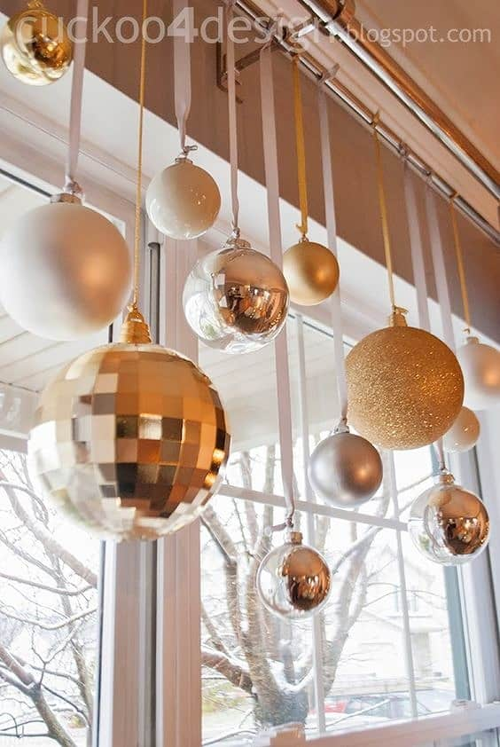 Easy DIY Christmas Hanging Ball ornament decoration using ribbon. A great idea for the mantle, window, ceiling, banister, or wall. Elegant budget decor for the home, party, or wedding.