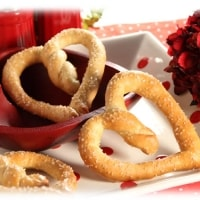 Easy DIY Heart Shaped Pretzels made out of Dinner Roll dough for Valentines Day Dinner and snacks. DIY boyfriend gifts.