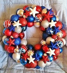 Easy DIY patriotic wreath Decoration idea using Christmas Ornaments. Easy 4th of July party ideas.