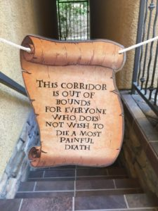 The Easiest, Most Creative, and Best Halloween Party Decorations That'll Keep Guests Out of bedrooms and in the party zone Using a Harry Potter print Out and Piece of String. Great dollar store idea.