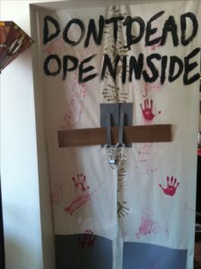 The best, easiest, and most creative Halloween Party Decorations using paper from the show the Walking Dead. Great idea for keeping guests out of bedrooms during a Halloween party.