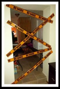 The Best easy Halloween Party Decorations That Will Keep Guests Out of other Rooms using Caution Tape. Great dollar store idea.