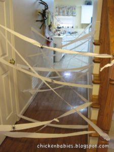 The Best easy Halloween Party Decorations That Will Keep Guests Out Using Crepe Paper or Cob Webs and Spiders. Great dollar store idea.
