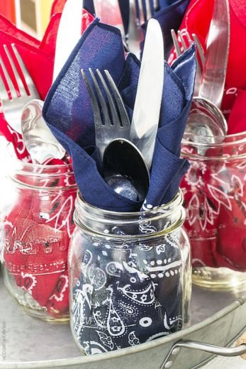 Mason jars holding utensils. Easy DIY 4th of July ideas for Food, and decorations.