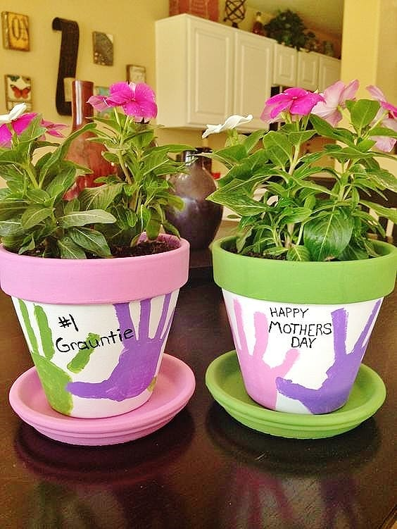 Easy DIY Hand Print Flower Pot Kids can make for Mothers Day. A great last minute gift idea.