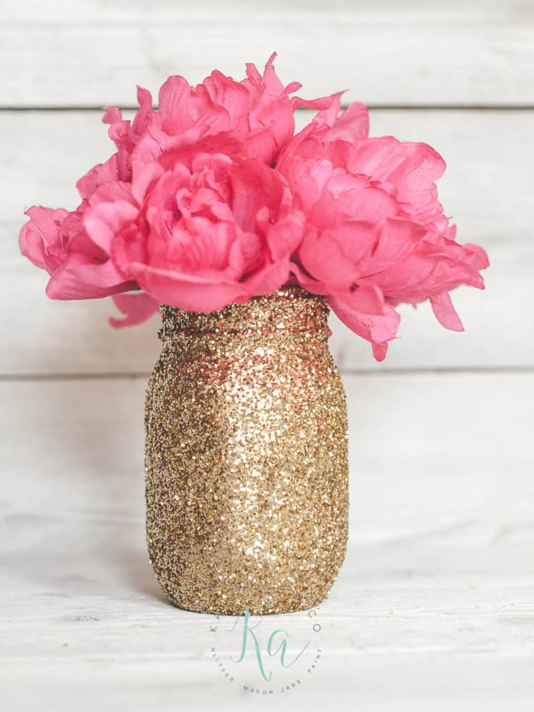 Easy DIY Glitter Mason Jar Vase Mothers Day craft kids can make. A great Home Decor gift idea you can do for Mom's, GrandMother, or Grauntie on a budget.