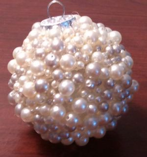Easy DIY Pearl Christmas Ornament That Looks Store Bought. Just use an old ornament, glue gun, and pearls or beads.