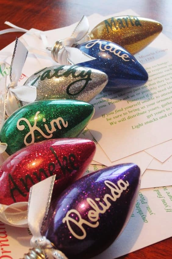 Easy DIY Glitter Bulb Christmas Ornament That Looks Store Bought. Easy to Make with Pledge and Glitter, can be customized for the perfect Christmas gift. Just use Ribbon to hang. Cricut projects.