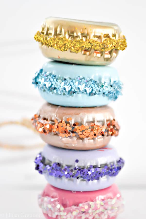 Easy DIY Glittery Macaron Christmas Ornaments That Look Professional and you'll actually want to keep. They're made with Paint, bottle caps, glitter and glue. An adorable craft or gift idea.