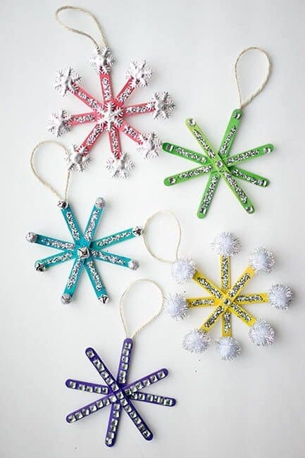 Easy DIY Glittering Popsicle Snowflake Ornament. Simple yet beautiful dollar store craft gift idea anyone can make, even kids,