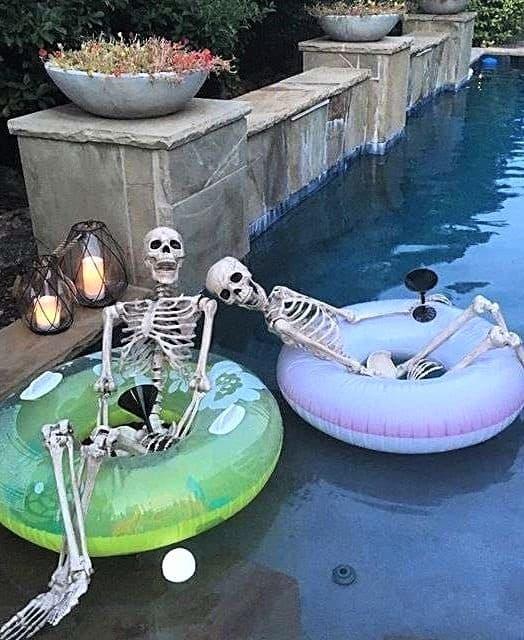 Skeletons floating in the pool