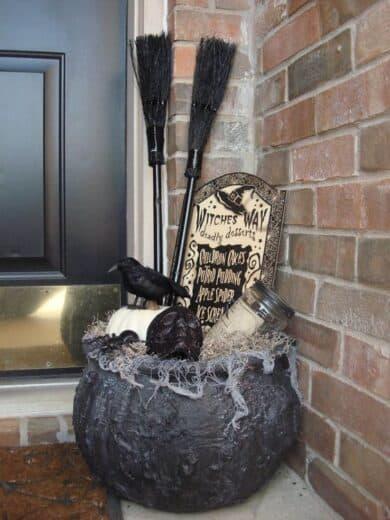 Halloween witches caulderon decor on porch